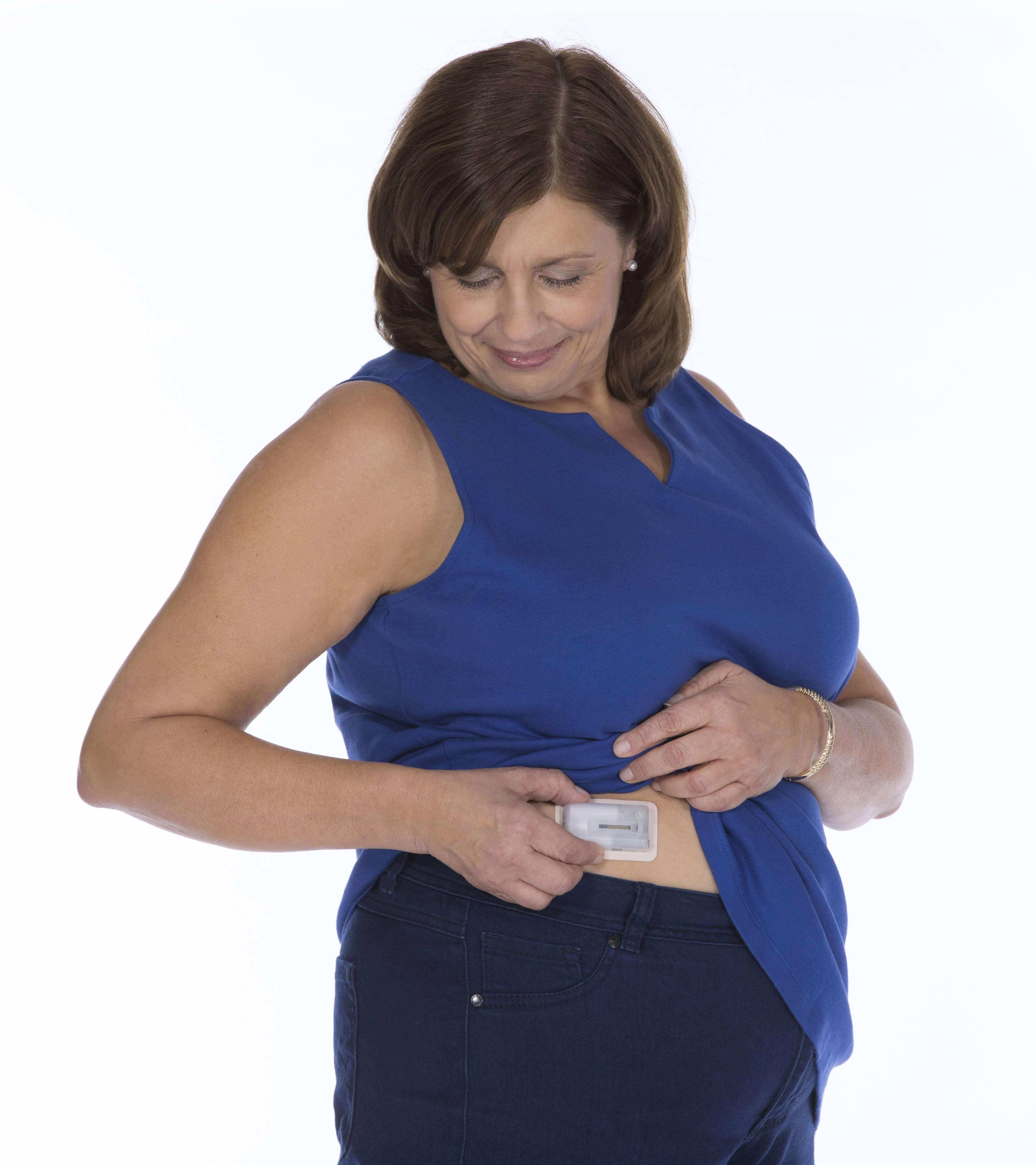 Women checking her V-Go® patch